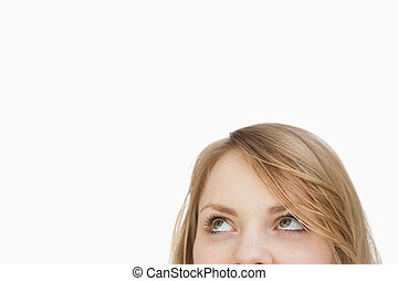 Blonde woman looking up