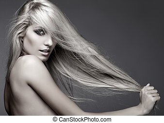 Blonde woman - Monochrome portrait of blonde young woman on ...