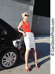 blonde woman near black auto