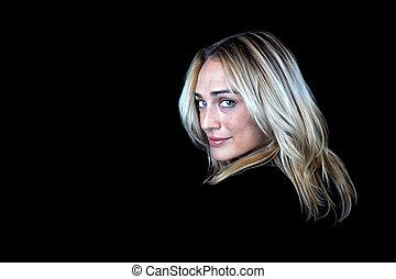 Blonde woman on black background.
