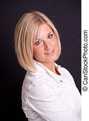 Blonde woman on black background