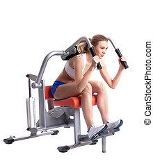 Blonde woman on isodynamic exerciser