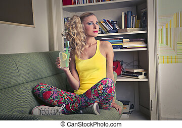 Blonde woman on sofa