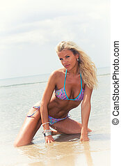 Blonde woman on the beach