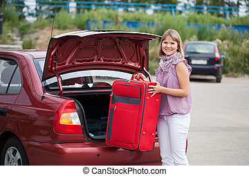 woman packing her baggage