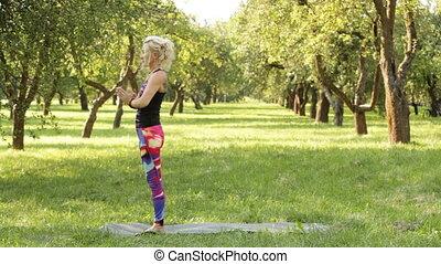 woman performing yoga exercises