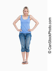 Blonde woman placing her hands on her hips
