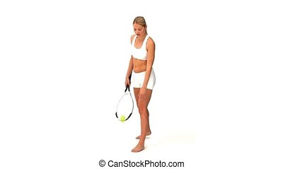 Blonde woman playing tennis in sportswear isolated on a...