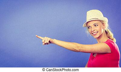 Blonde woman pointing at something