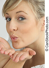 Blonde woman pulling air kiss
