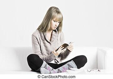 Blonde woman reading