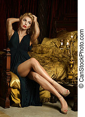 Blonde woman sitting on bed