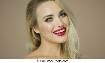 Blonde woman smiling and looking at camera - Headshot of...