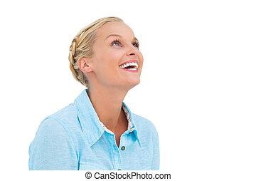Blonde woman smiling and looking up