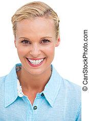 Blonde woman smiling at camera