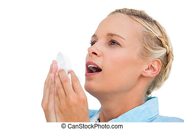 Blonde woman sneezing on white background