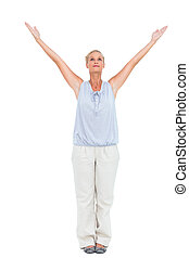 Blonde woman standing with arms outstretched on white...