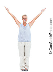 Blonde woman standing with hands up looking at camera