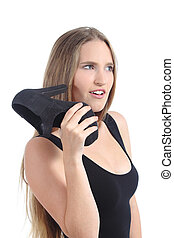 Blonde woman talking with a shoe phone