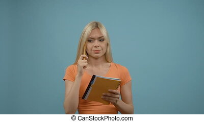 Blonde woman thinking about business, idea, isolated on blue background