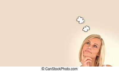 Blonde woman thinking about moment with her friend at...