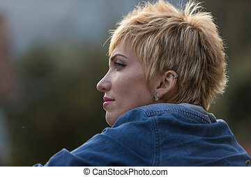 blonde woman thinking outdoors portrait