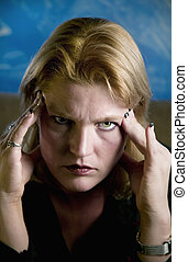Blonde Woman Touching Forehead