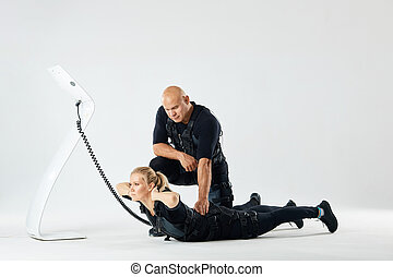 woman training with a man in rehabilitation center