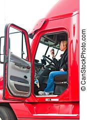 Blonde woman truck driver - Pretty blonde woman in a big rig...