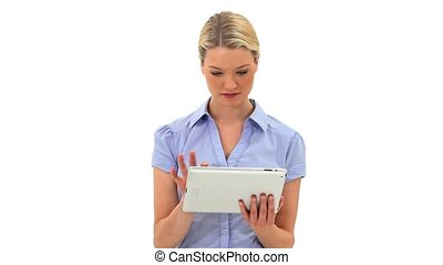 Blonde woman using a tablet computer