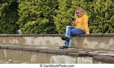 Blonde woman using smart phone