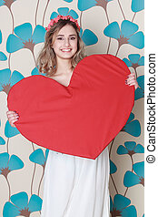 blonde woman with a big red heart