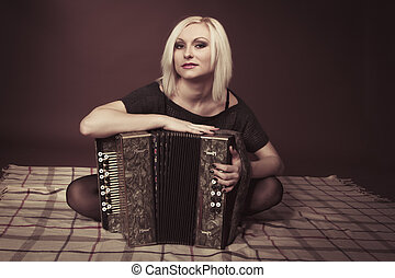 Blonde woman with an accordion