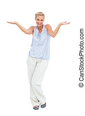 Blonde woman with arms raised in question
