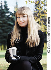 Blonde woman with coffee cup