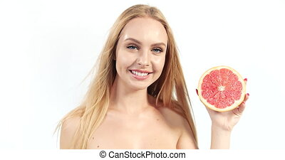 Blonde Woman with Grapefruit on White - Beautiful blonde...