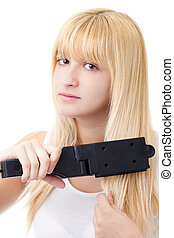 Blonde Woman with Hair Straightener