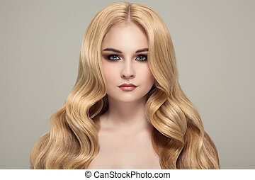 Blonde woman with long curly beautiful hair.