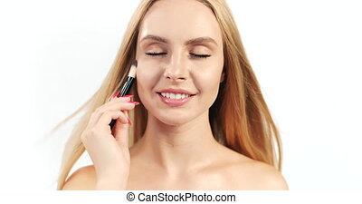 Blonde Woman with Makeup Brush Closeup