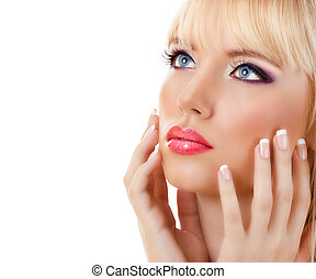 Blonde woman with manicure and purple makeup