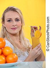 Blonde woman with orange juice