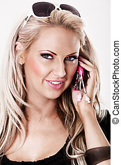 Blonde woman with pink makeup talking on phone