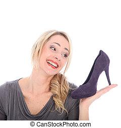 Blonde woman with purple shoe - Studio portrait of an...