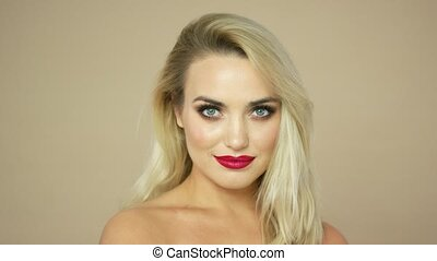 Blonde woman with red lips - Headshot of positive woman with...