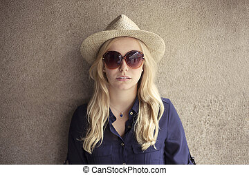 Blonde woman with straw hat