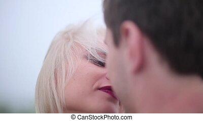 Blonde women and brunette men kissing