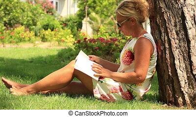 blonde women reading a book