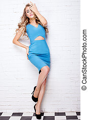 Blonde young girl in blue dress. - Blonde beautiful young...