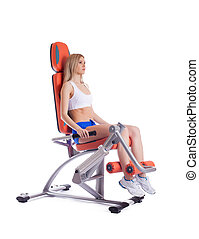 Blonde young woman on exerciser