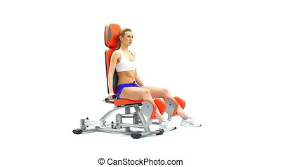 Blonde young woman on isodynamic exerciser